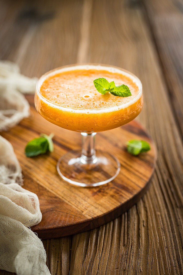 Simple summer bellini with apricot and fresh mint