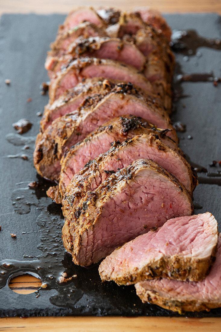 Sazon rub beef roast with chimichurri Argentina