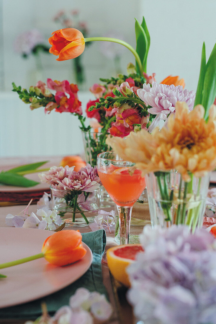 A table laid with flowers and pink grapefruits for Mother's Day