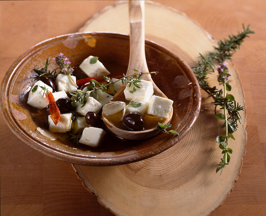 Greek sheep's cheese pickled in olive oil with garlic, thyme, rosemary, herbs, chilli and olives