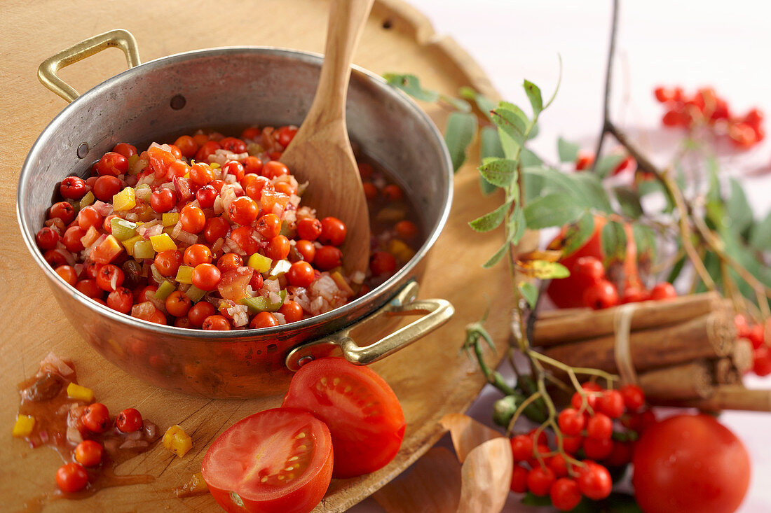 Rowan chutney with tomatoes, peppers and sultanas being made