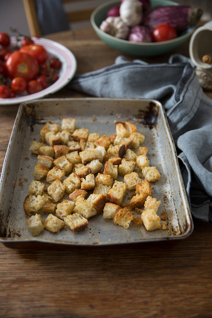 Homemade croutons on a baking tray