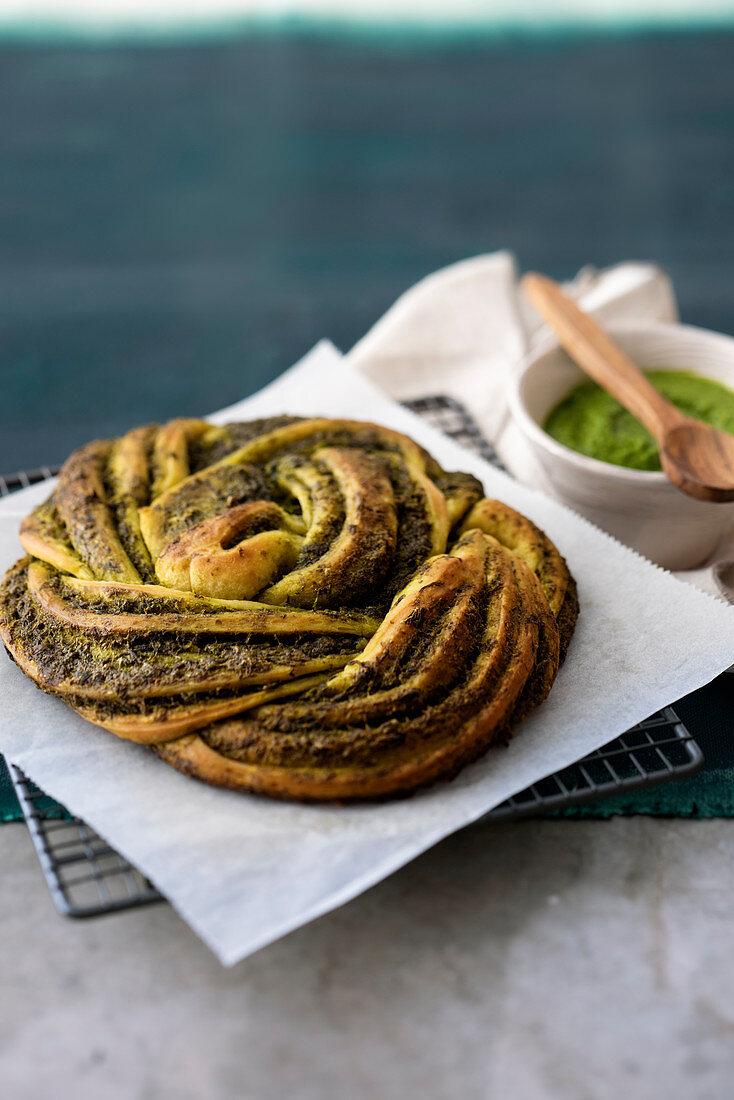 Braided bread wreath with pesto genovese