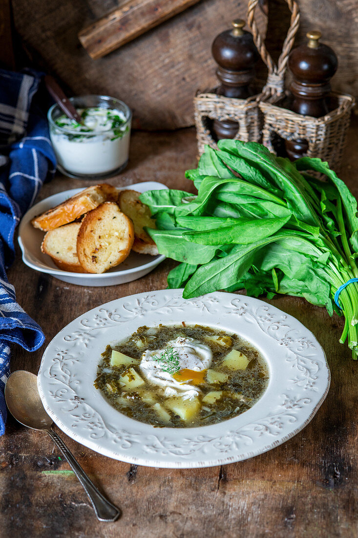 Potato and dock leaf soup with poached eggs