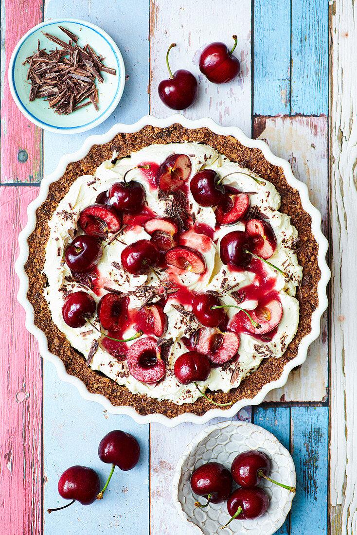 Chocolate almond tart with cream and cherries