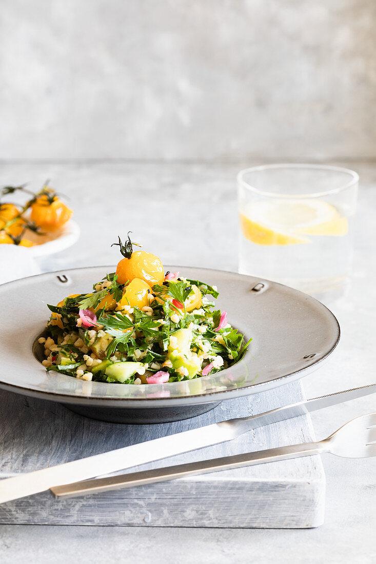 Bulgur tabbouleh salad with yello tomatoes