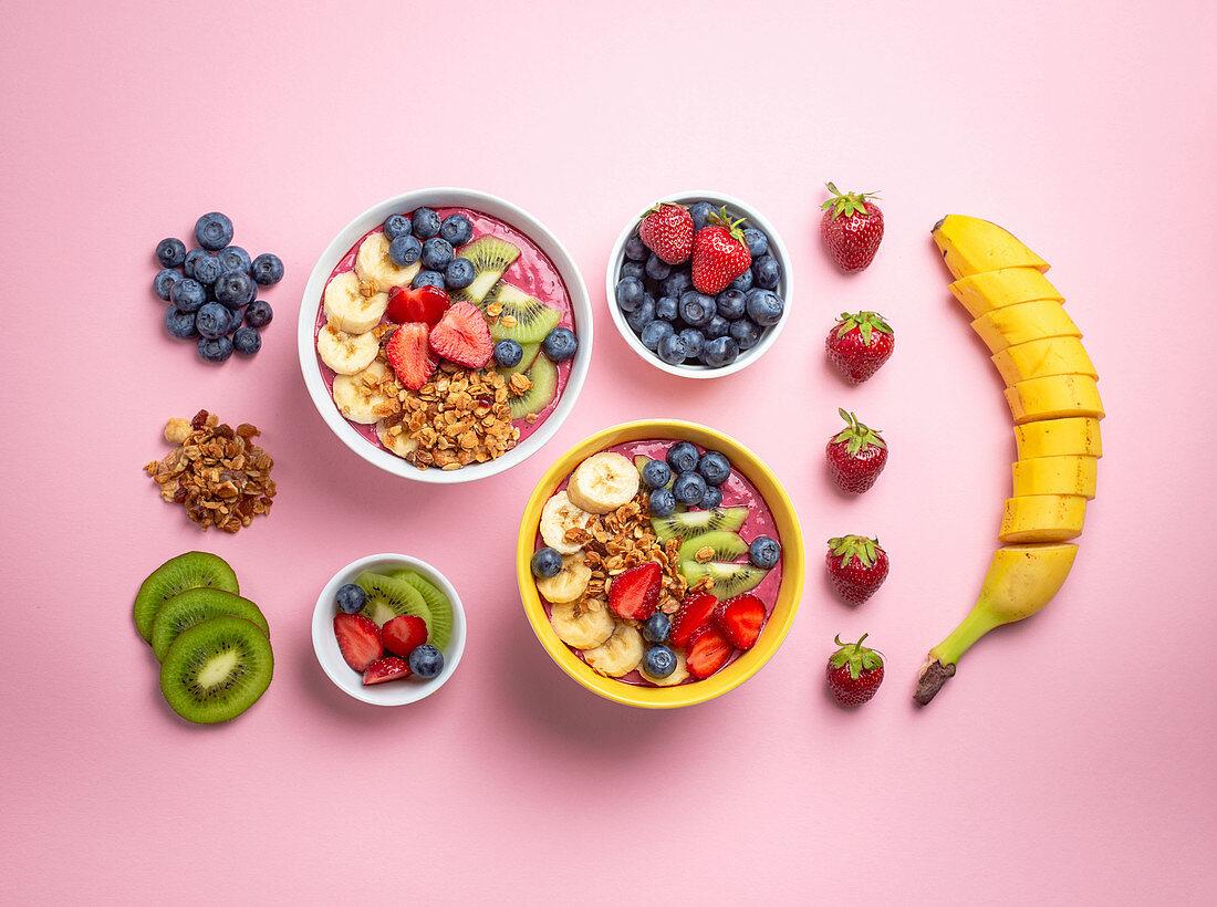 Acai smoothie with strawberries, bananas, blueberries, kiwi and granola