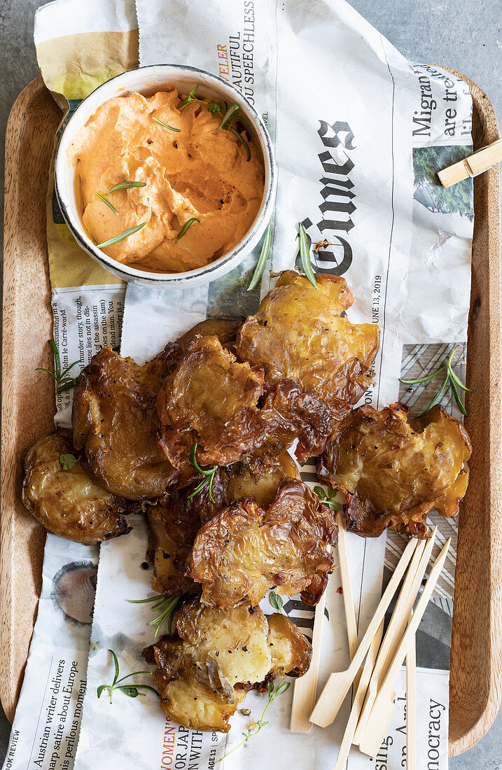 Roasted smashed potatoes with a harissa and tahini dip