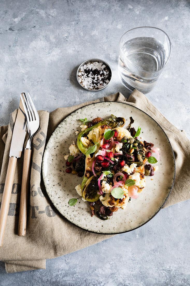 Cauliflower steak with a salad