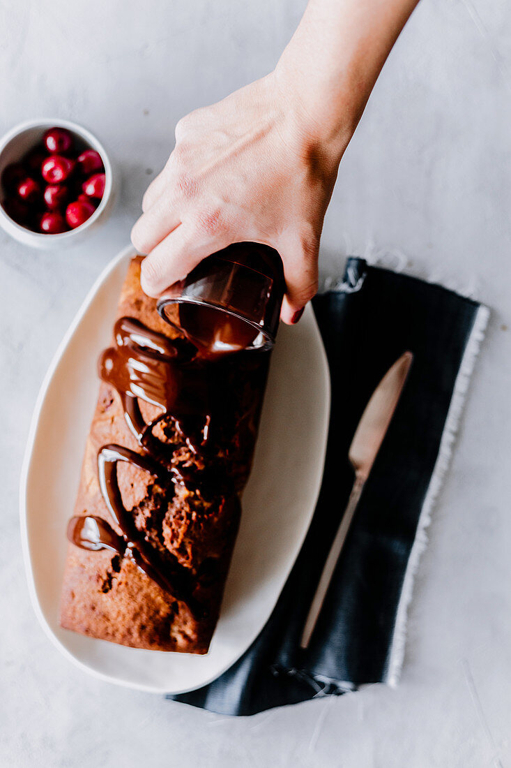 Marble cake with cherries, drizzled with chocolate glaze