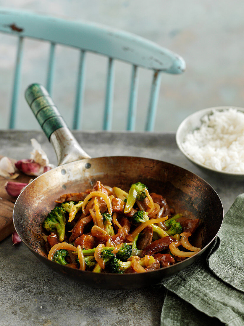Wok fired meat and vegetables with rice (China)