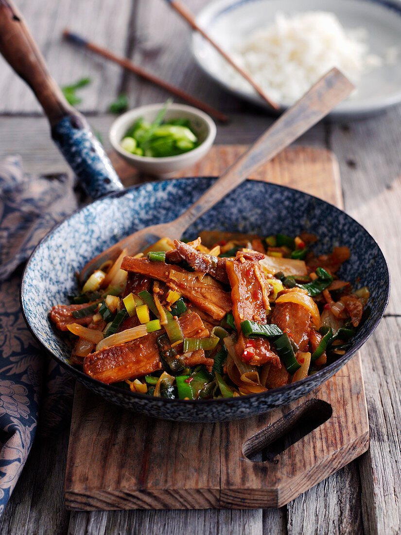 Spicy double boiled pork belly with leek (China)