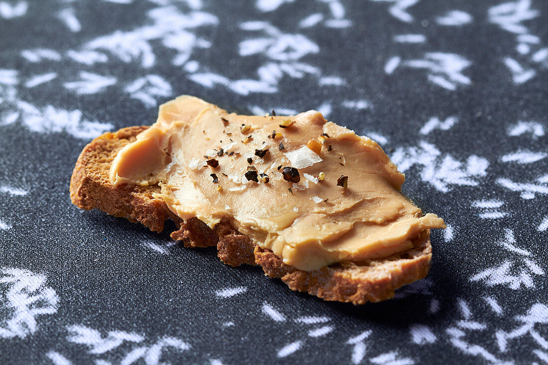 Toast with foie gras, salt and pepper
