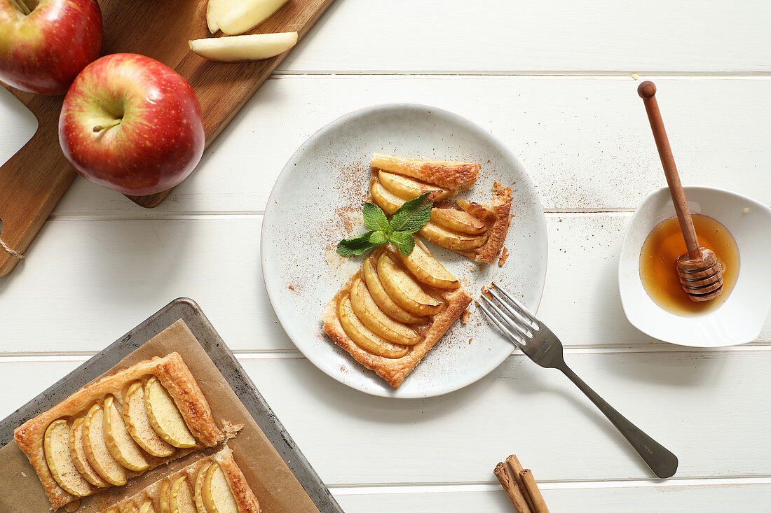 Tasty apple pie with honey and mint leaves with cinnamon
