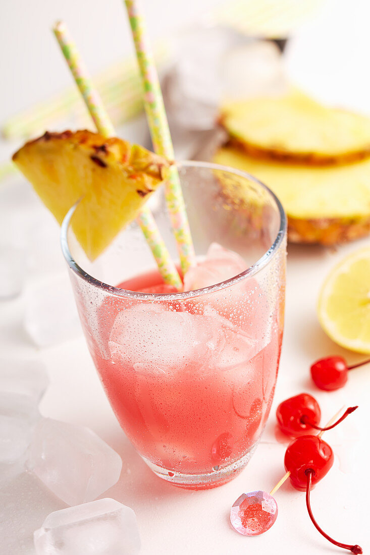 Singapore Sling with gin, cherry liqueur, grenadine, pineapple, orange and cocktail cherry