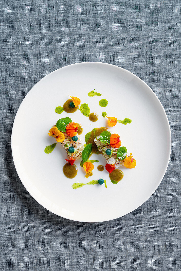 Sashimi with curacao melon, watercress blossoms and leaves