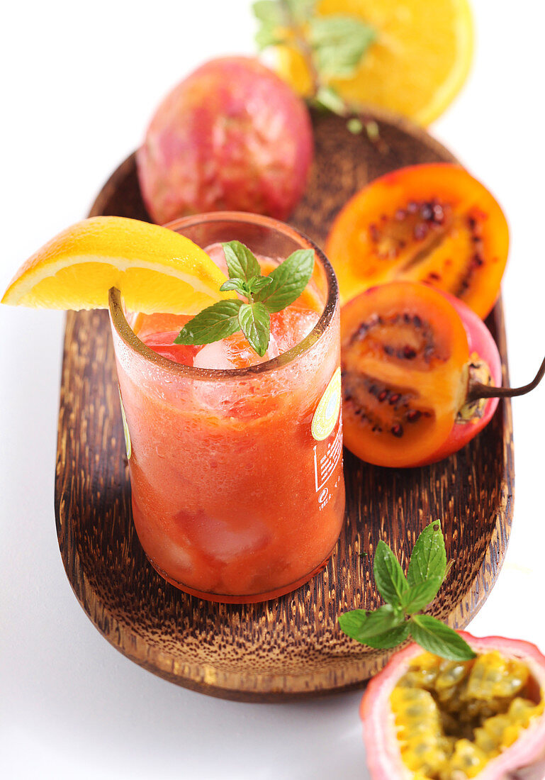 A homemade tamarillo smoothie with passion fruit