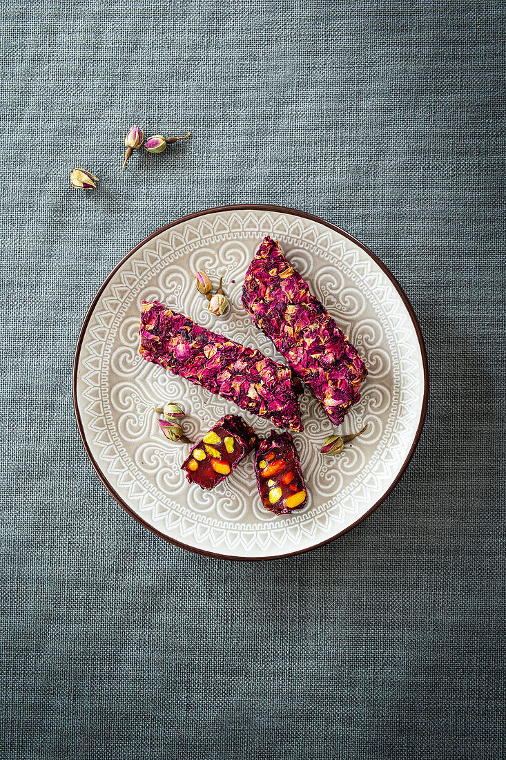 Lokum with pomegranate syrup, pistachio nuts and rose petals (Levant cuisine)