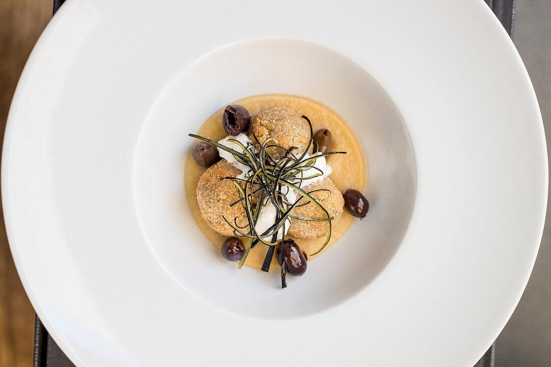 Thyme-flavored aubergine balls on chickpea puree