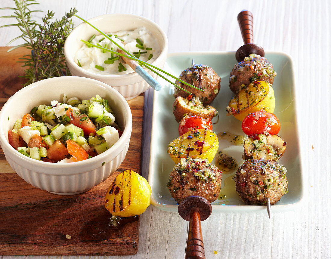 Grilled minced meat kebabs with millet salad and sour cream