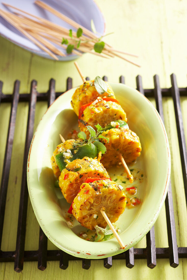 Grilled corn cob and pepper skewers as a summer side dish