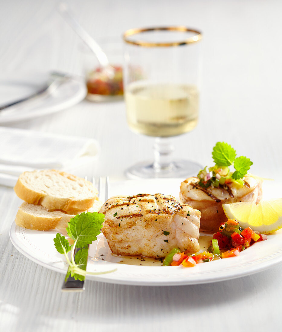 Grilled monk fish medallions with pepper salsa, lemon and white bread