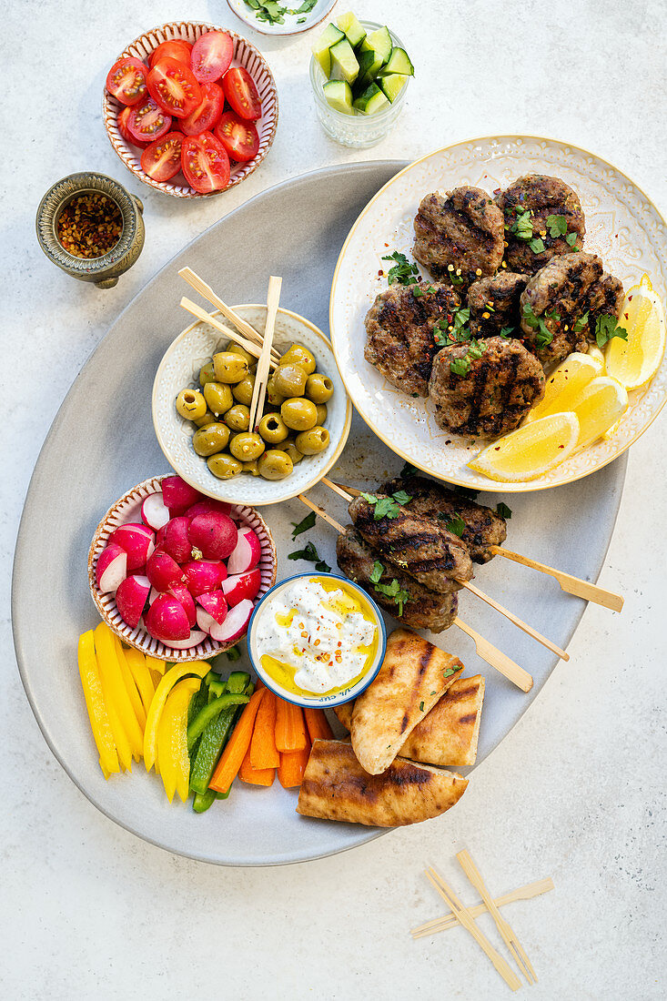 Lamb kofte with vegetable side dishes