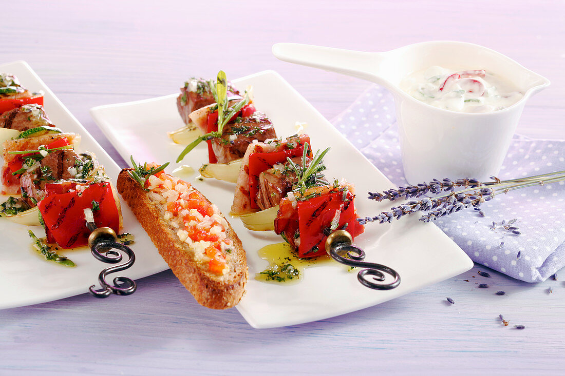 Marinated, grilled lamb skewers with a spring onion dip and crostini