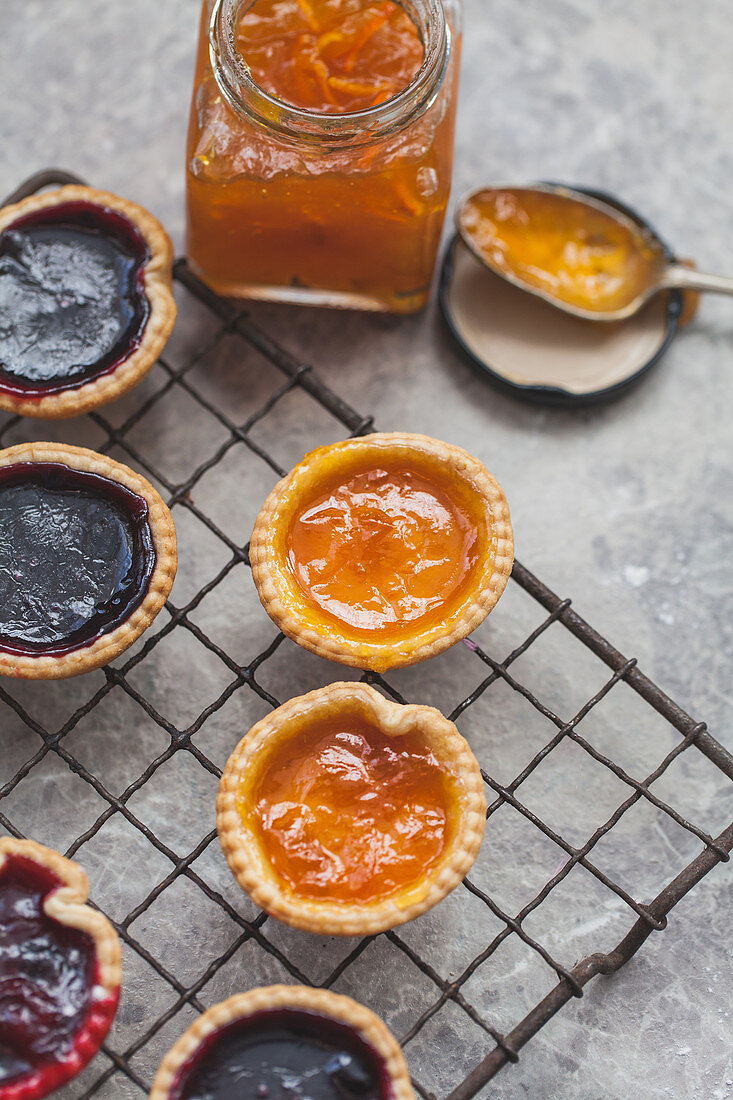 Jam tarts on a cooling rack