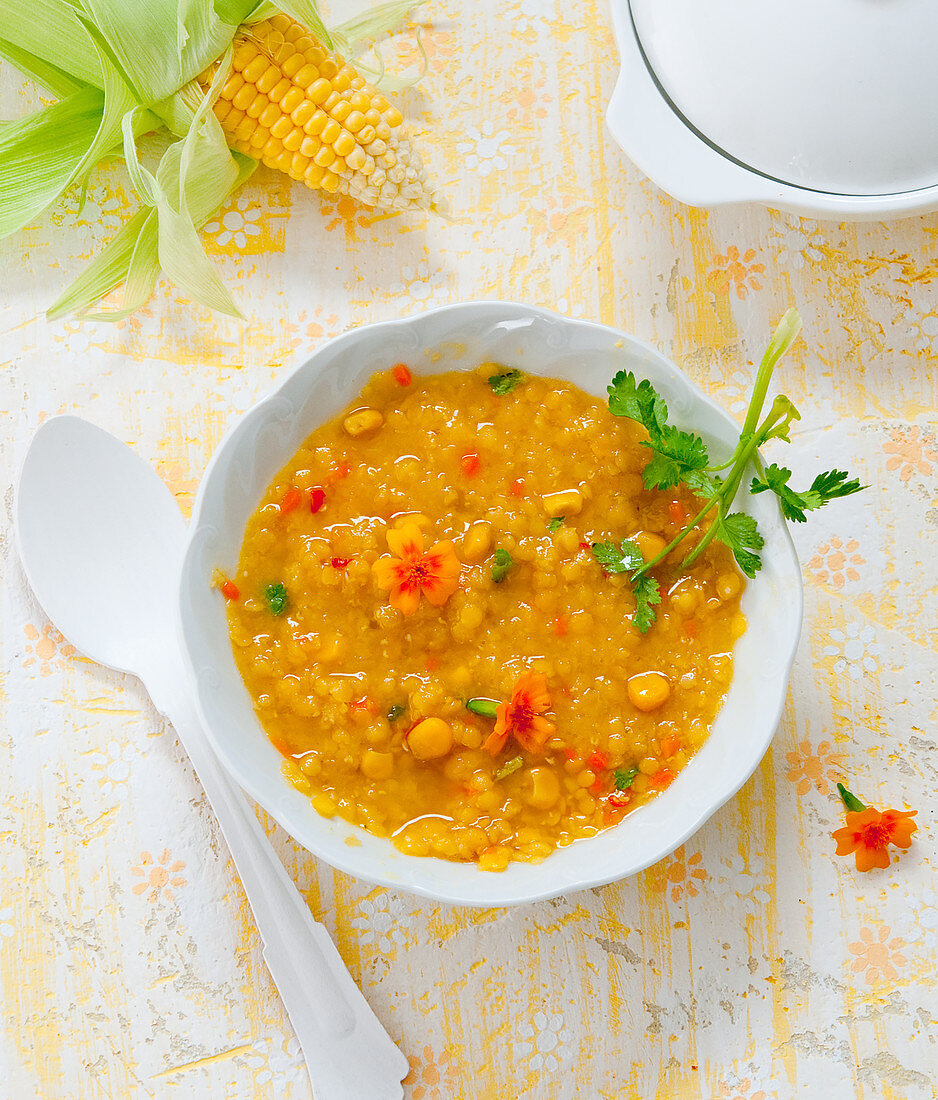 Corn chowder with coriander and flowers