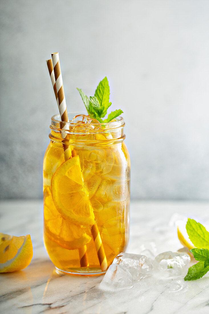 Homemade refreshing sweet iced tea with lemon