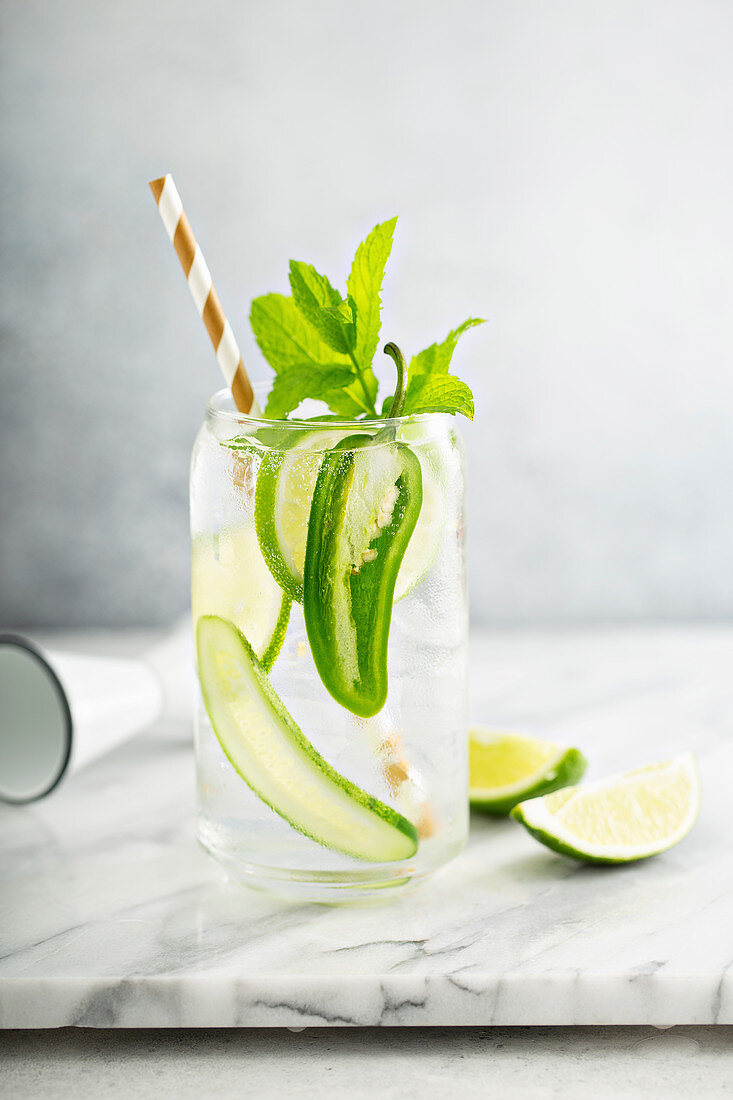 Spicy and refreshing cocktail with lime and cucumber