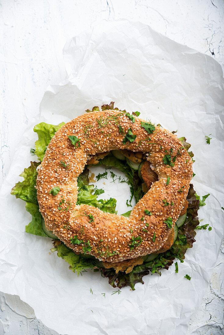 Simit (Turkish sesame seed wreath) with falafel, salad, cucumber and herbs – vegan