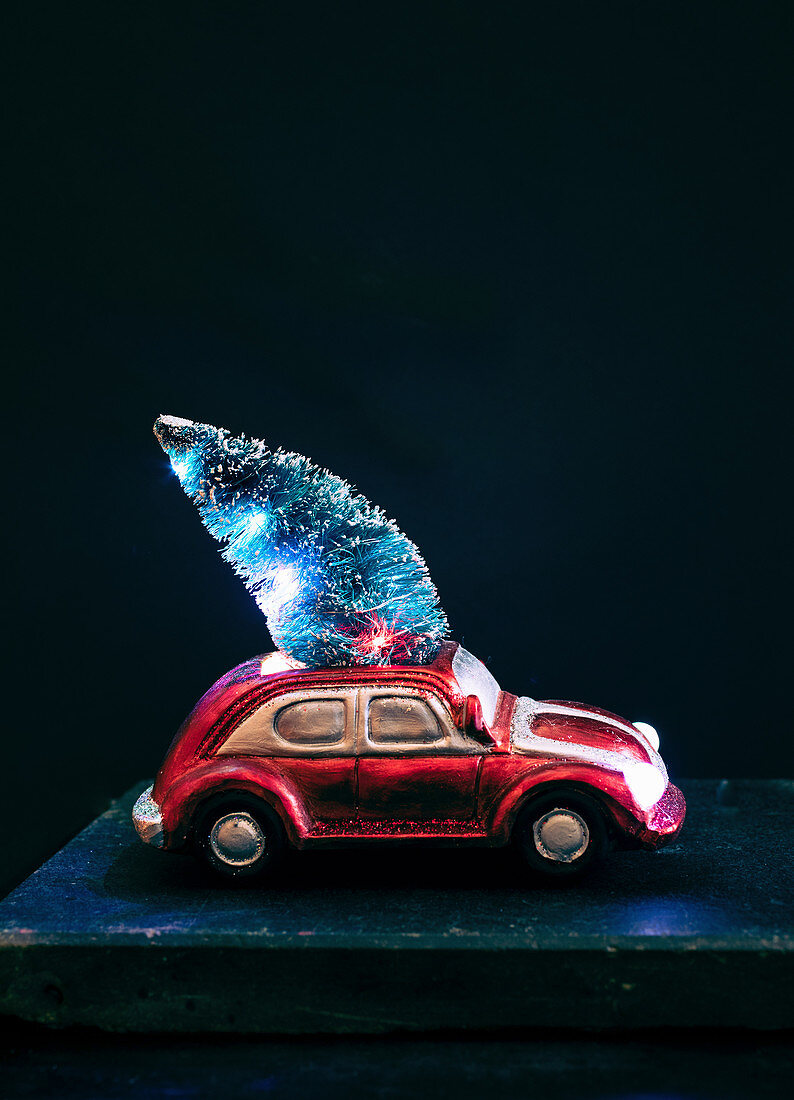 Christmas decoration: small toy car with Christmas tree