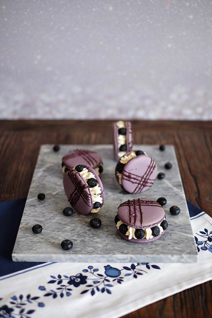 Blueberry macaroon tartlets with cream