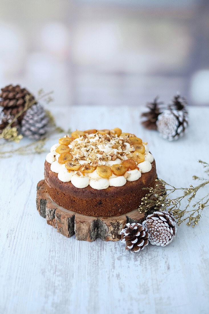 A Christmas pineapple cake with a cream cheese topping and bananas