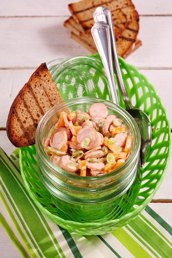 Hotdog sausage salad to take away in a jar