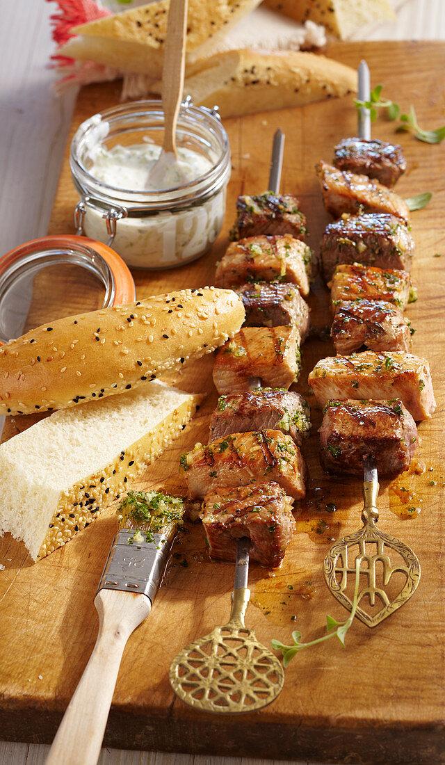 Souvlaki - grilled marinated meat skewers with Cretan tzatziki