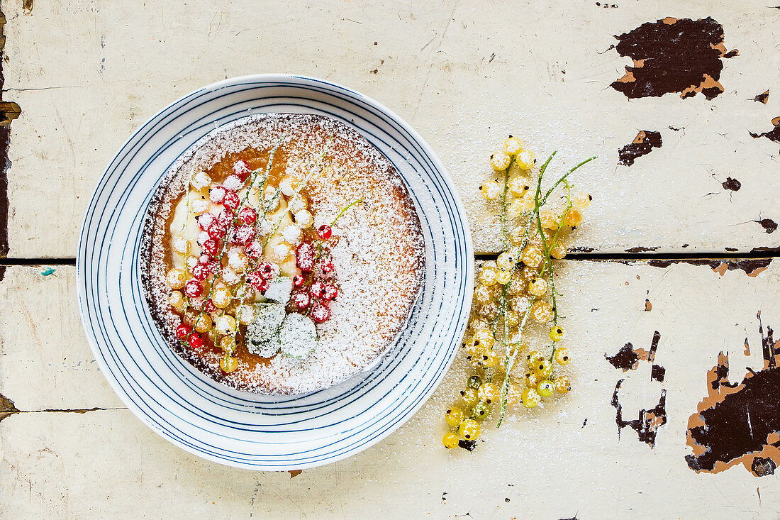 Danish pancake with red and white currant berries
