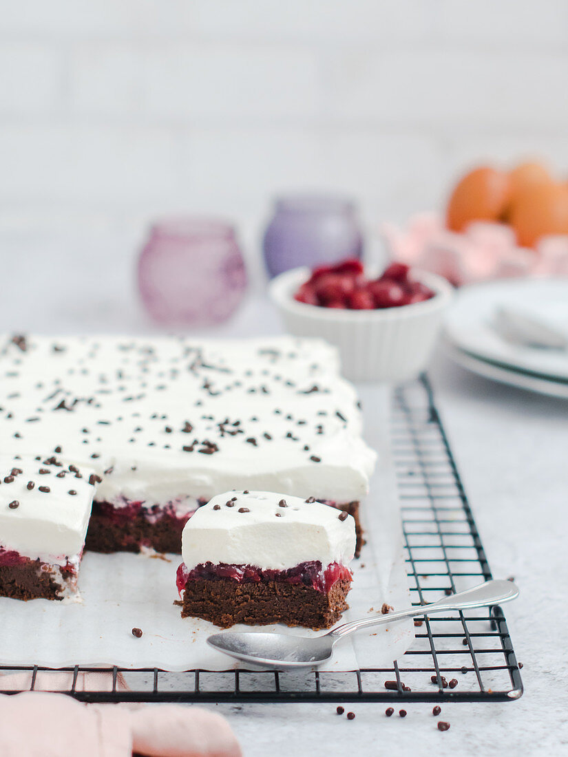 Chocolate cake without flour, with cherry and whipped cream