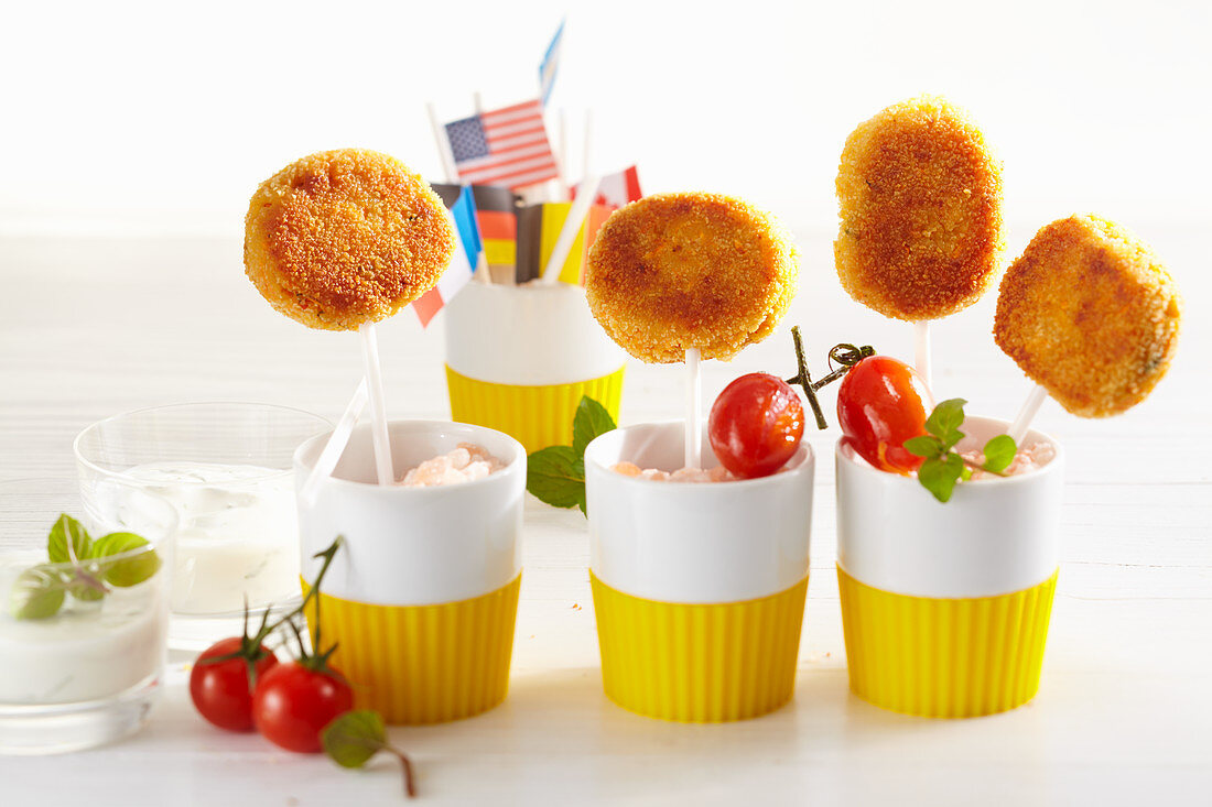 Chickpea fritters on sticks with a dip