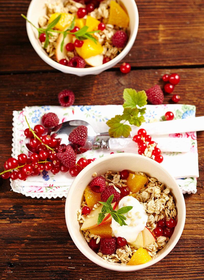 Bircher muesli with oats, fresh berries, apples, orange, milk, honey, yoghurt and almonds