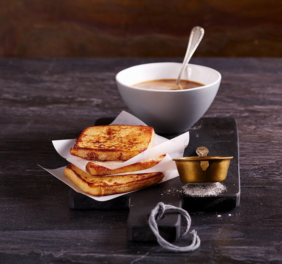 French toast with cinnamon sugar with a café au lait