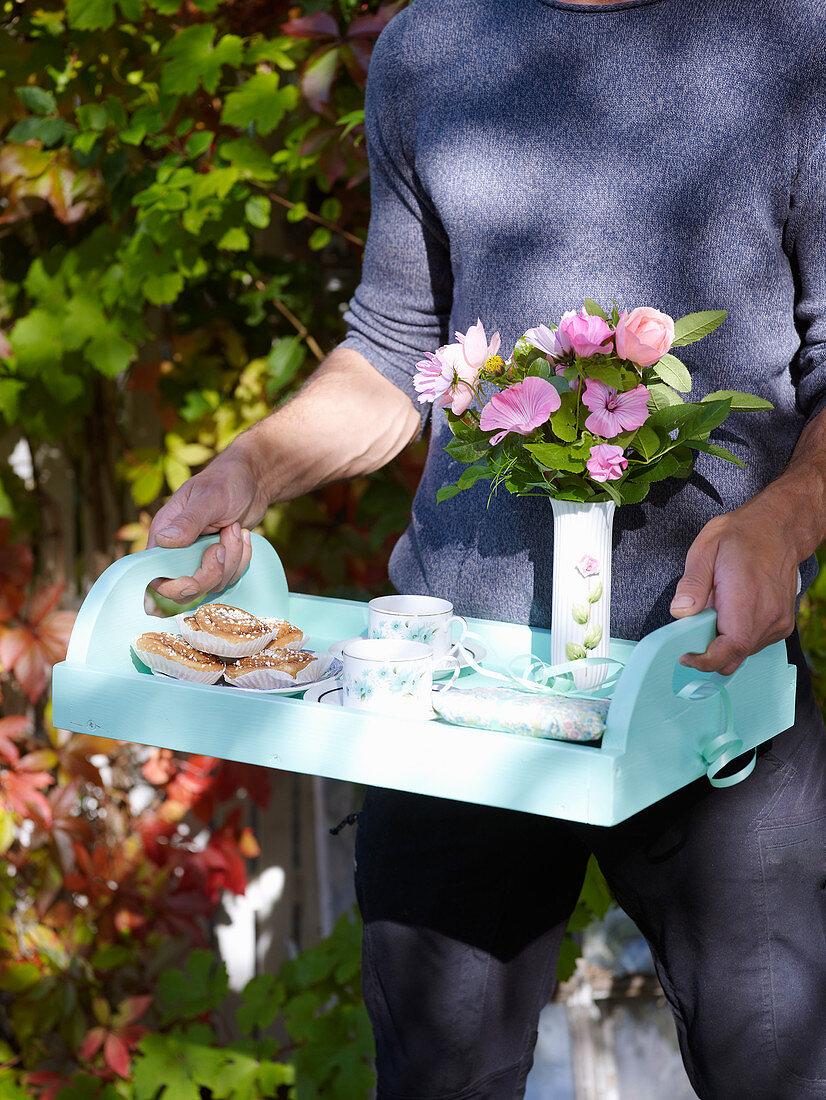 Man holding tray