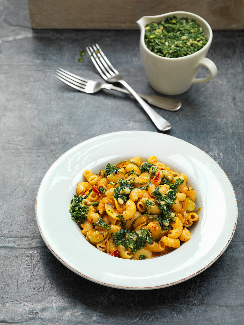 Pasta with yellow and green zucchini and herb pesto