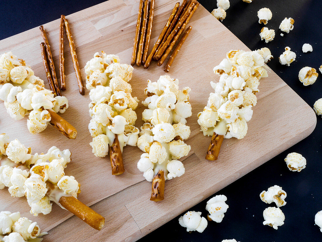 Large pretzel sticks with white chocolate and popcorn