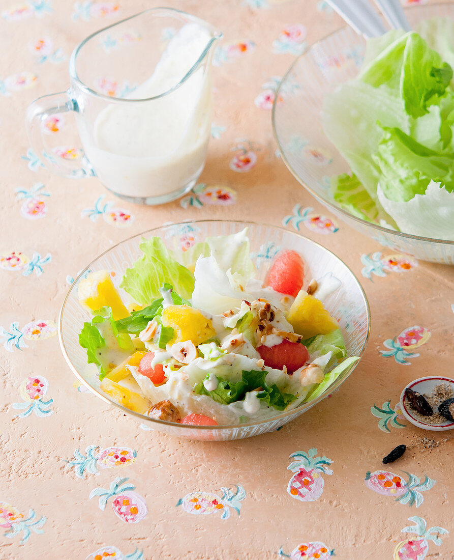 Iceberg lettuce with fruit and yogurt-tonka sauce