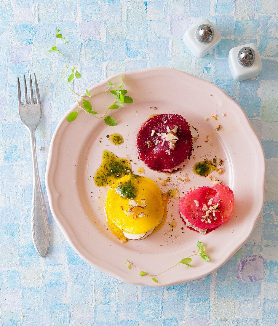 Red and yellow beet ravioli with hazelnut pesto