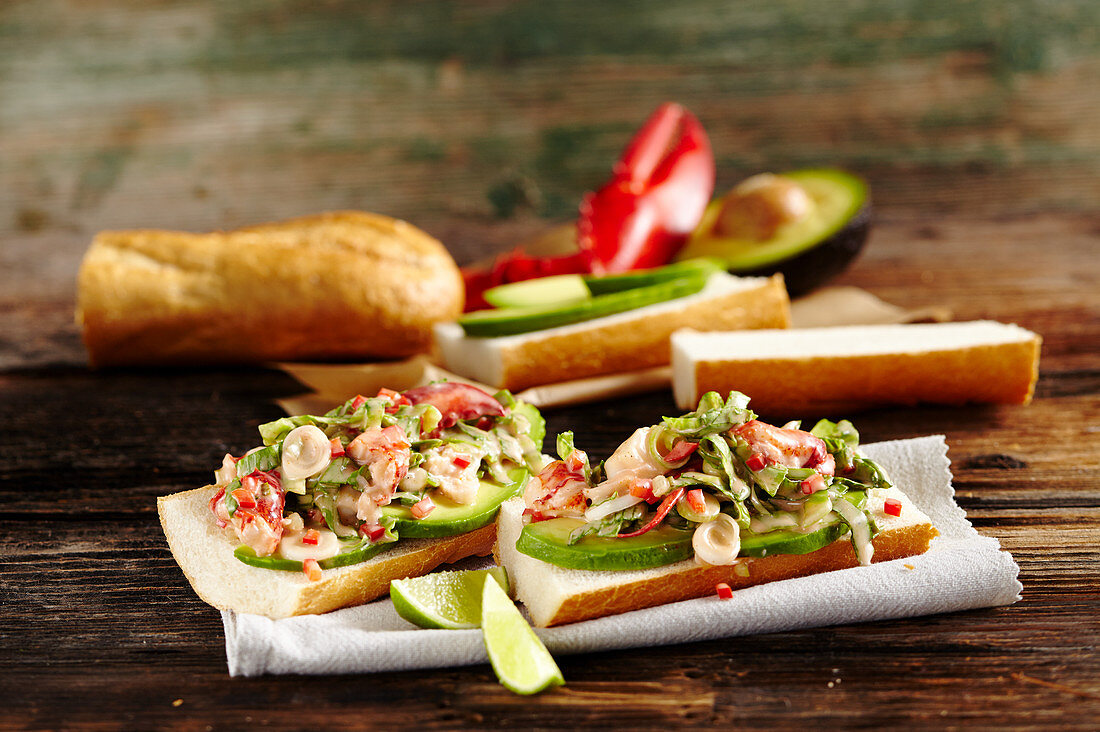 Sandwiches with lobster cocktail, avocado and lime
