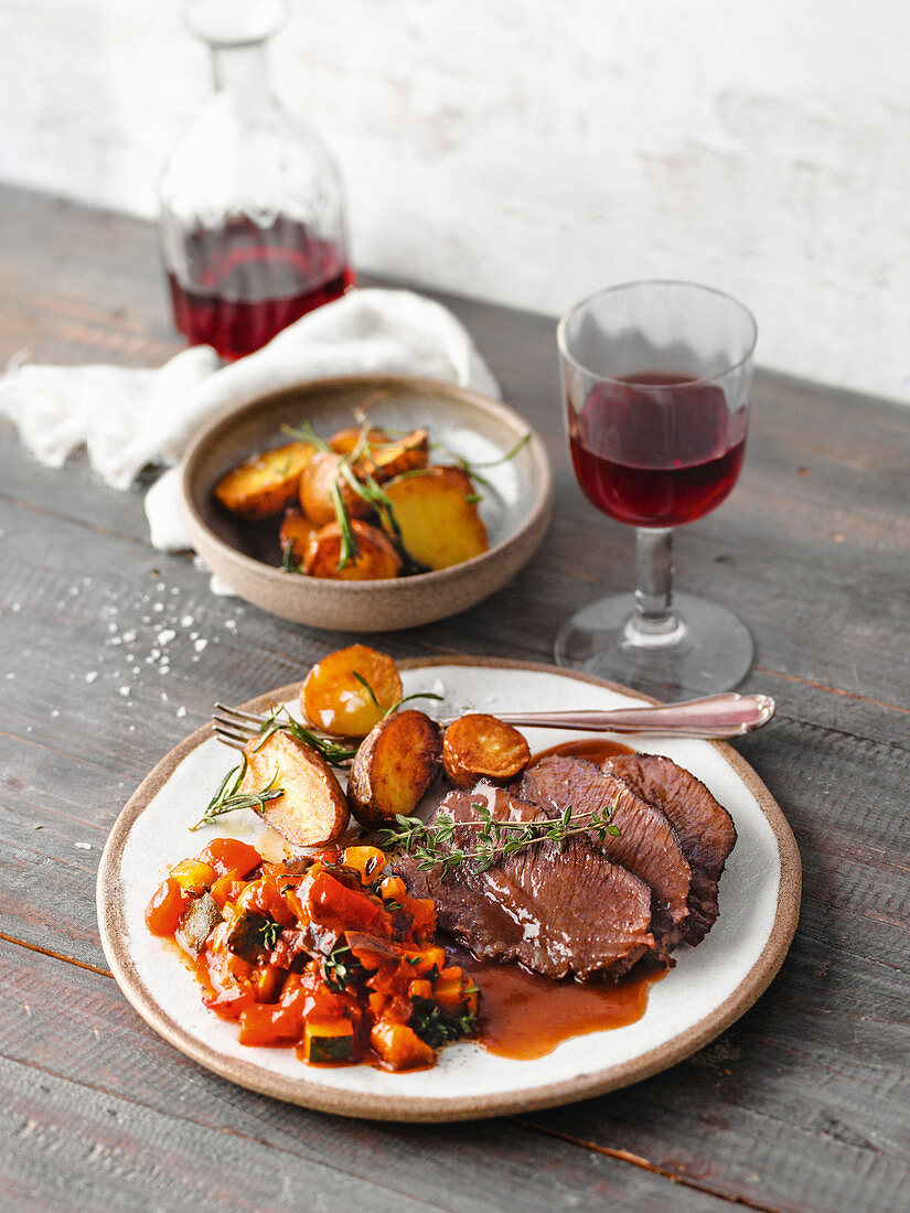 Braised beef cheeks in a red wine sauce with ratatouille